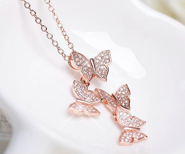 ROSE GOLD MULTI BUTTERFLY DROP NECKLACE