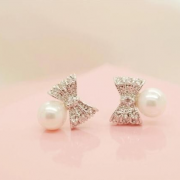 PEARL AND BOW STUD EARRINGS